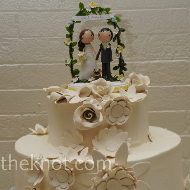 The couple's all-white cake was decorated with fondant flowers, which mirrored the paper flower decorations.