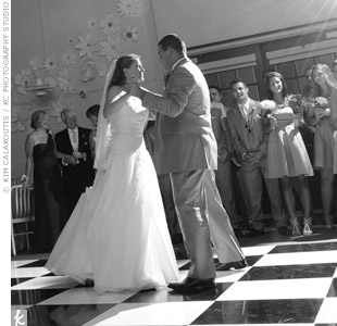 "The couple danced to Michael Buble's ""Everything"" beneath old-fashioned string lights."
