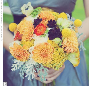 Dahlias, dusty miller, ranunculus, garden roses, craspedia and chocolate cosmos made up the vivid bridesmaid bouquets.
