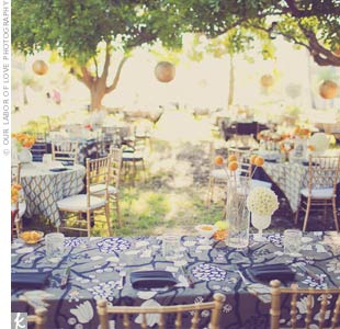 Lesley's mother sewed the table linens out of fabric from IKEA. The pattern and colors (gray, gold, mustard and black) inspired the wedding's palette.