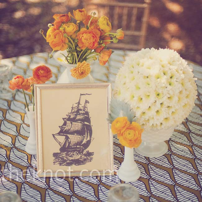 Antique vases and clusters of orange roses, craspedia and stock made up each retro centerpiece.