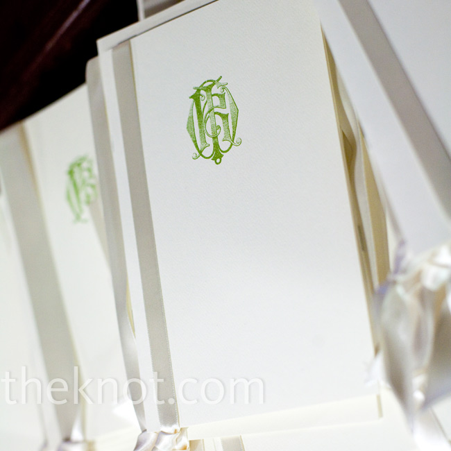 Katie's mother and a family friend designed the simple programs with a green monogram on the cover.