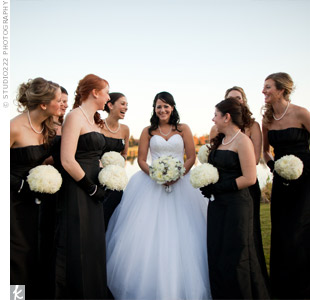 The bridesmaids wore formal black dresses with black gloves and pearls.
