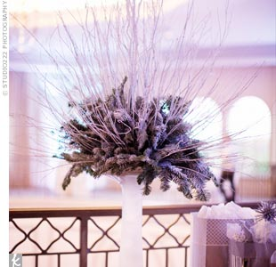 A tall arrangement of evergreen and birch branches were set in a frosted-glass vase on the gift table.