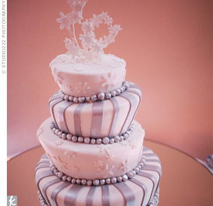 Topsy-turvy tiers, bold patterns and shimmering fondant gave the couple's cake a whimsical look.