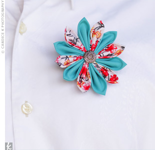 The guys wore fabric flower boutonnieres crafted by Amanda.