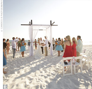 The ceremony chairs were arranged in a circle around the draped huppah for an intimate feel.