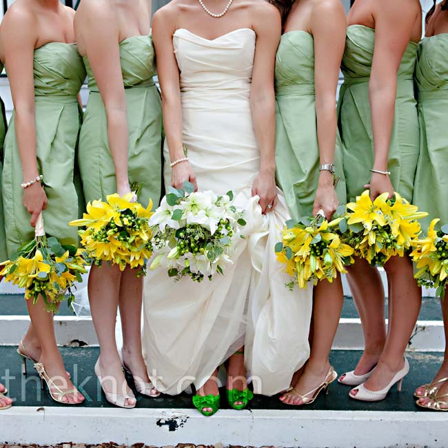 Brittany's bridesmaids customized their meadow-green knee-length dresses with their own accessories and carried bright yellow bouquets.