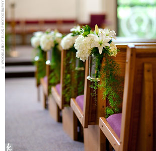 Small bouquets of lilies, hydrangeas and hypericum berries marked off the reserved ceremony pews.