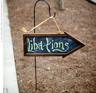 "The couple incorporated subtle southern details, like a chalkboard sign pointing the way to ""libations."""