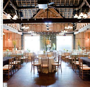 Varied table shapes and linens, along with hanging bulb lights, warmed up the refurbished-barn reception.