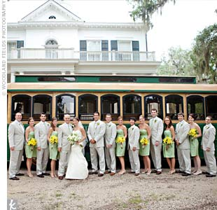 A green-and-gold trolley (it matched the color palette!) took the couple's wedding party from the ceremony to the reception.