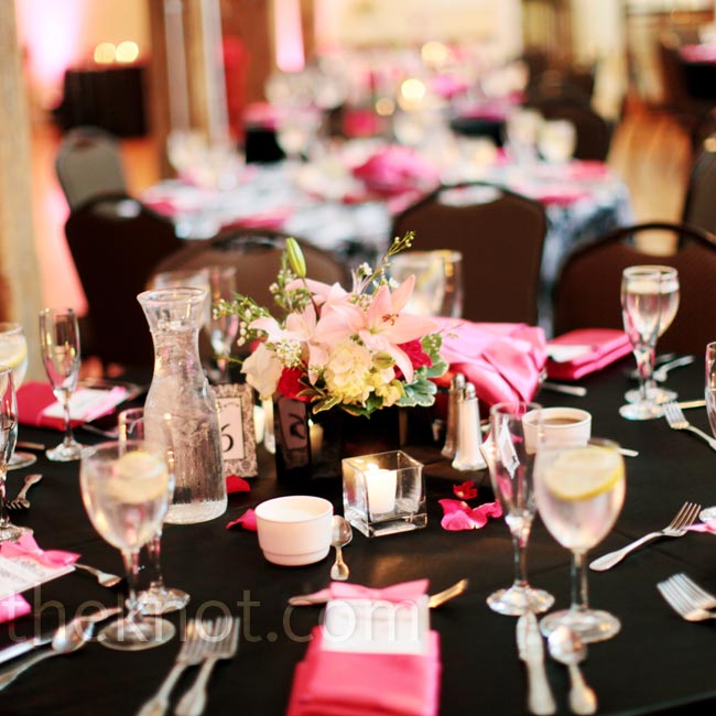 For a dramatic contrast, fuchsia napkins were used with black table linens and arrangements of pin and white roses, white hydrangeas and pink lilies.