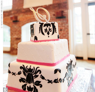 The couple's signature black-and-white damask pattern covered the top and bottom tiers of the cake.