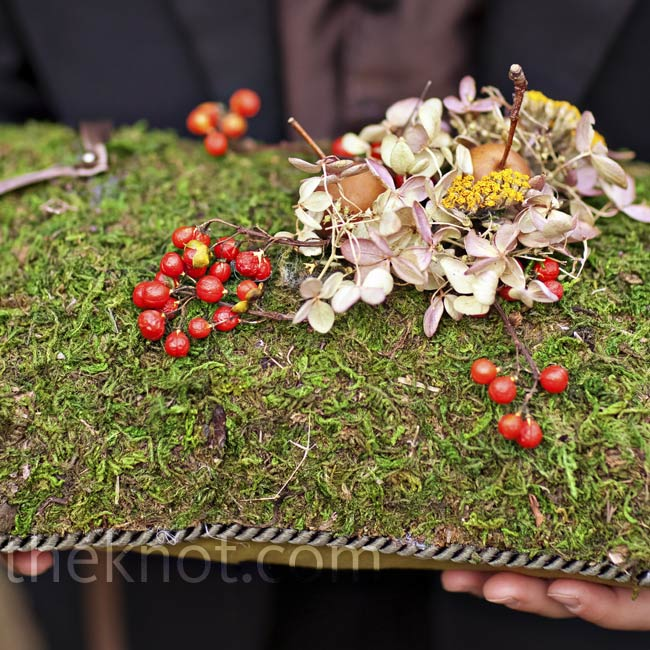 The ring bearer carried a moss-covered ring pillow to blend in with the fall décor.