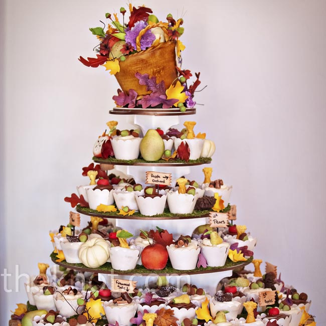 Apples, haystacks, firewood and acorns added a seasonal feel to the cupcake display. Topping the tower was a basket filled with fruits, vegetables and fall foliage.