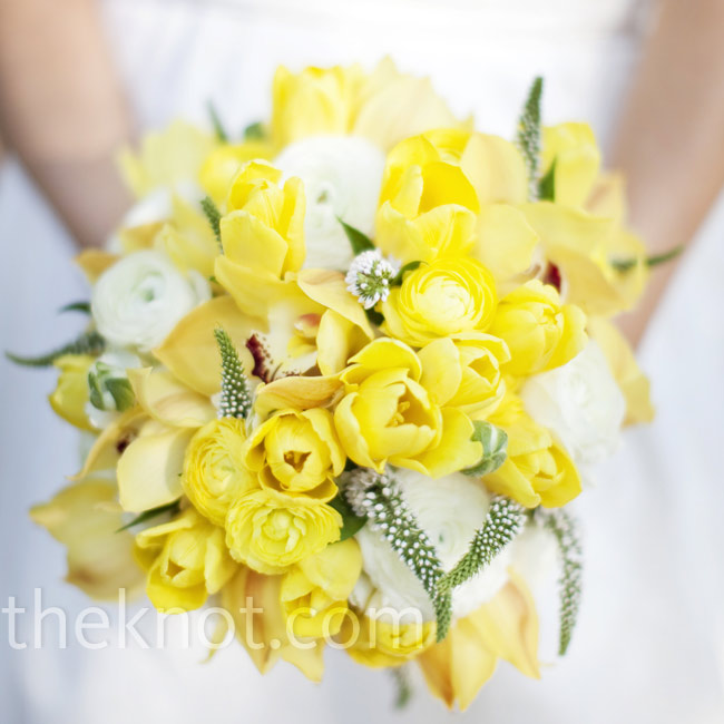 Cheery yellow roses, orchids and ranunculuses, broken up with strategically placed white blooms, made up Mandy's bouquet.