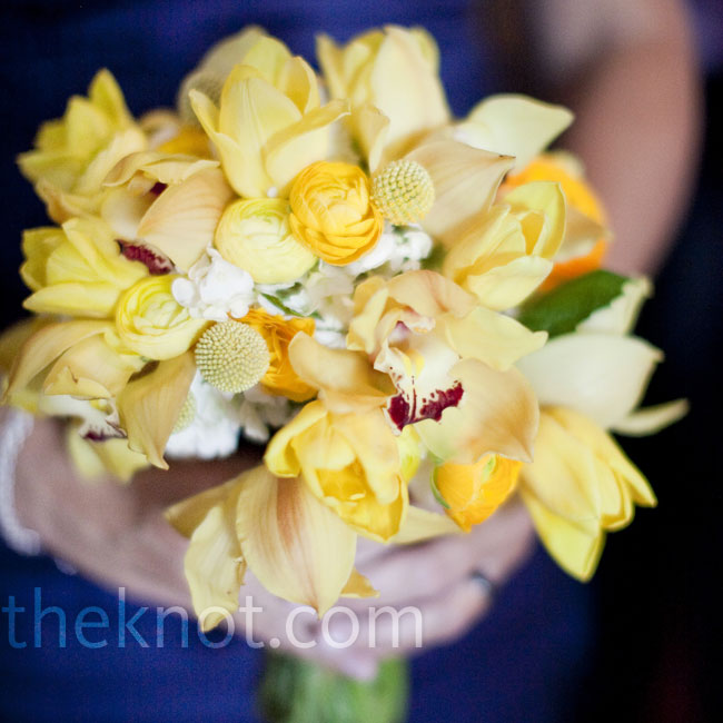Mandy's bridesmaids carried bright yellow bouquets that matched the bride's and popped against their navy blue dresses.