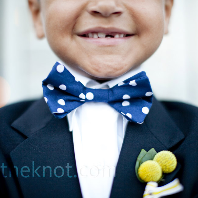 Mandy's second cousin wore a navy ring bearer suit with a handmade navy and white, polka dot bow tie.