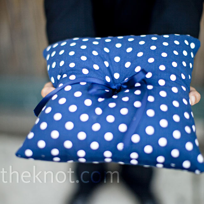 A custom blue and white polka dot pillow, an Etsy.com find, matched the ring bearer's fun bow tie.