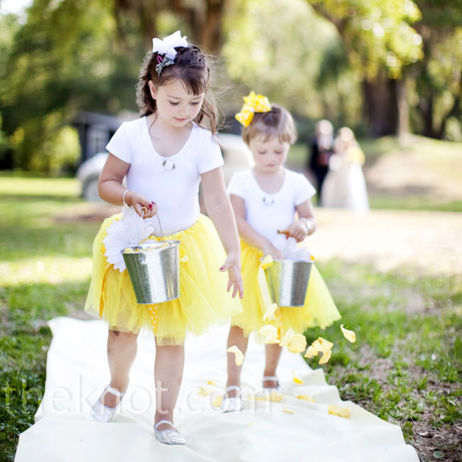 The flower girls wore adorable yellow tutus and scattered petals they carried in silver pails.