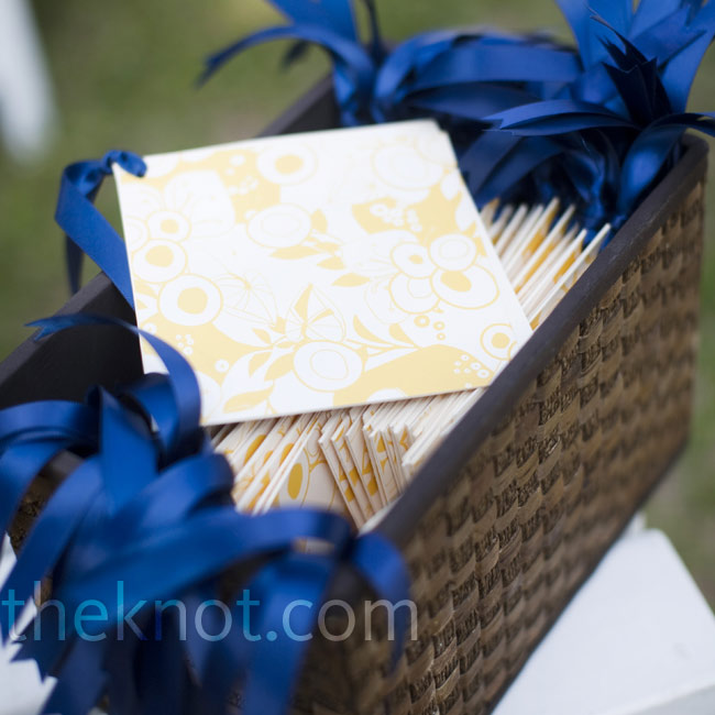 The chic yellow and white ceremony programs tied with navy bows complemented the football team-inspired colors.