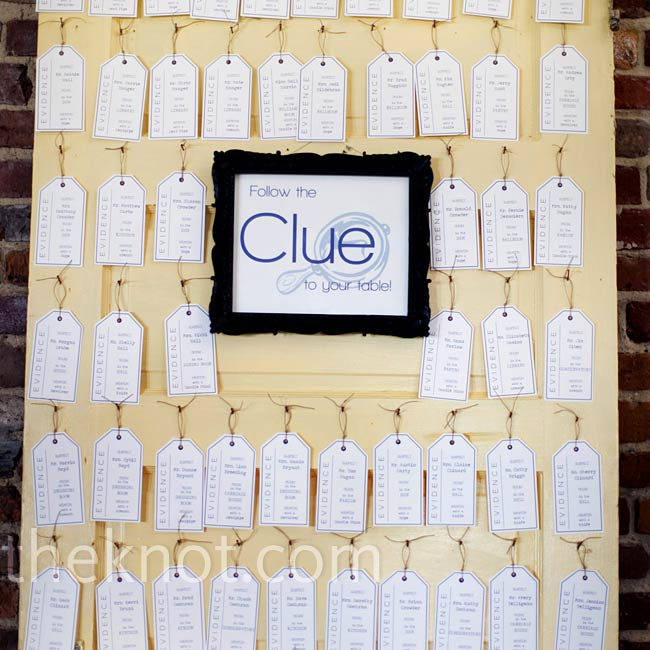 Further tying into their Clue theme, the couple used printed evidence tags as their escort cards and hung them from an antique door.