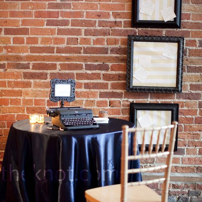Guests spelled out well-wishes for the newlyweds on an antique typewriter, and then hung the notes on framed boards nearby.