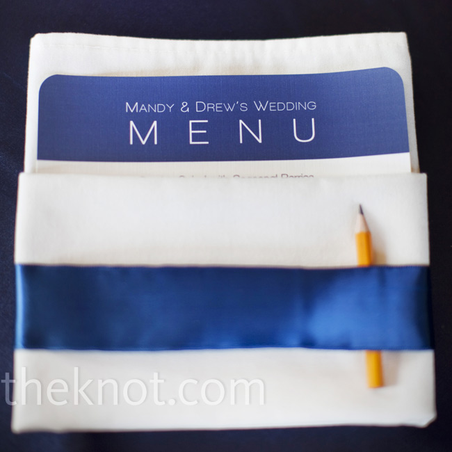 The menus were printed on navy and white personalized menu cards, wrapped in white linen napkins and displayed with matching navy ribbon bands.