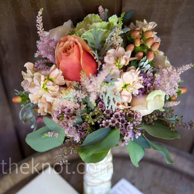 The couple's florist put together a soft-colored mix of nontraditional blooms and greens for Lindsay's laid-back, rustic bouquet.