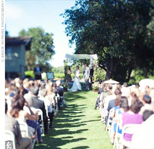 The couple had a modified traditional Jewish wedding ceremony and exchanged vows beneath a huppah on the lawn outside the barn.