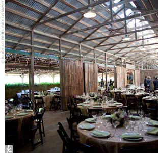 Round tables were set up inside the barn. Beige and pale-green linens kept the natural look going.