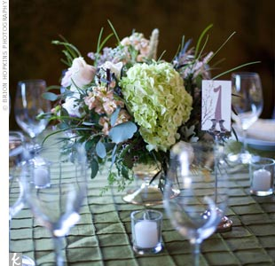 Low arrangements of pastel-colored hydrangeas, roses and greens topped the dinner tables.