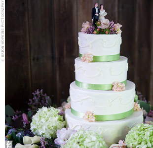 Surrounded by flowers, the cake was finished with the same bride and groom cake topper that had been Lindsay's grandparents'.