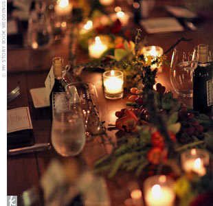 Instead of centerpieces, wildflowers, grapes, moss and candles were dotted down the middle of the table, serving as a runner.