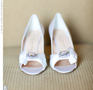 Beths satin pumps were dyed to match her ivory dress. The brooches and bows on the peep toes gave them a romantic feminine look.