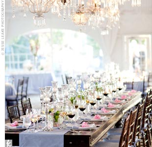 Beth and Dave opted for a simple blue table runner to keep the wood of their head table exposed. A line of chandeliers hung directly above for a dramatic look.