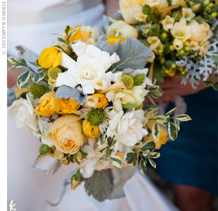 Hong and her maid of honor carried yellow and white bouquets of roses, craspedia and varied greens for lots of texture.