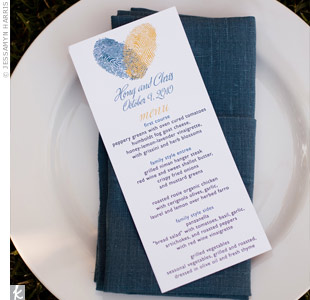For the menu cards, the couple's planner amped up the fingerprint hearts by using two ink colors.