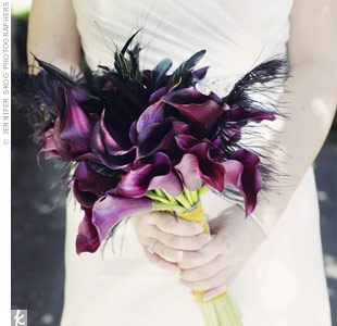 Christine carried dark-eggplant calla lilies and black feathers.