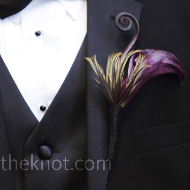 Derrick's boutonniere was accented with a feather and a fiddlehead fern.