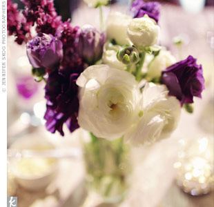 Arrangements of roses and lilacs topped the tables.