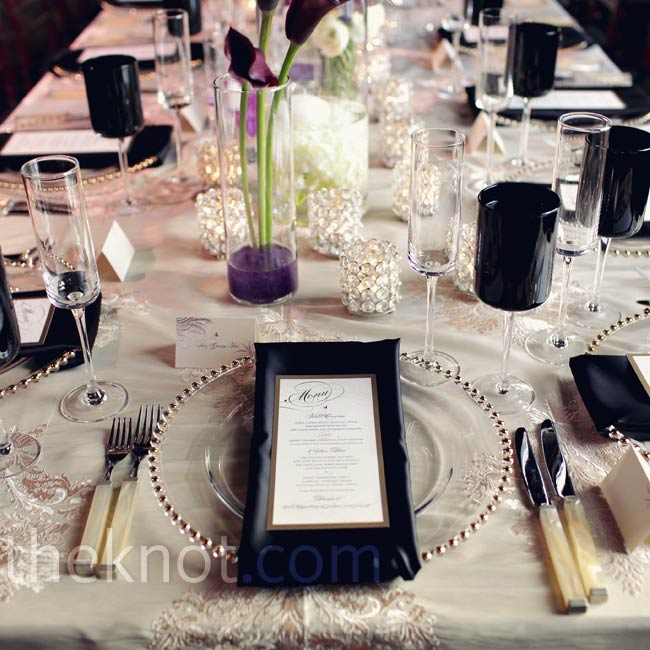 Black and lace linens and clear, gold-beaded chargers kept the tables in theme.