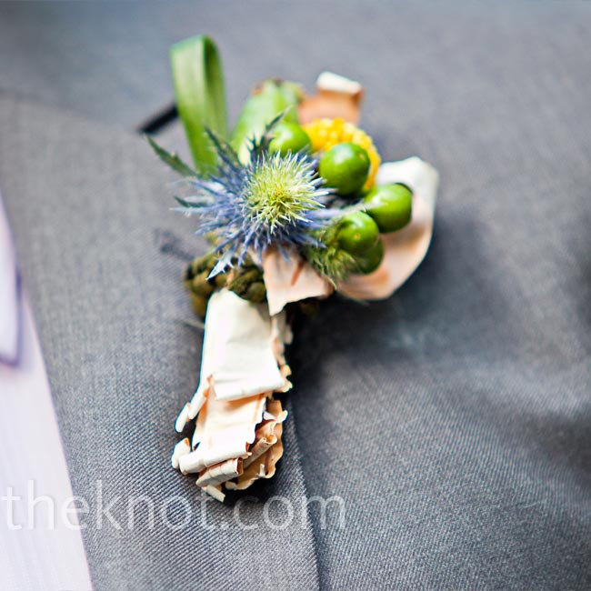 The groom and guys wore boutonnieres of berries and thistle accented with bark.