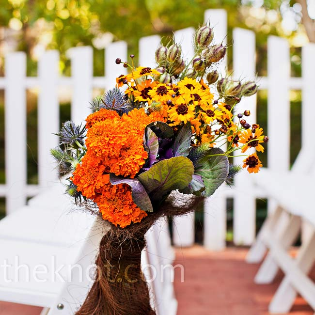 Natural-looking bouquets of wildflowers and leaves decorated the chairs along the ceremony aisle.