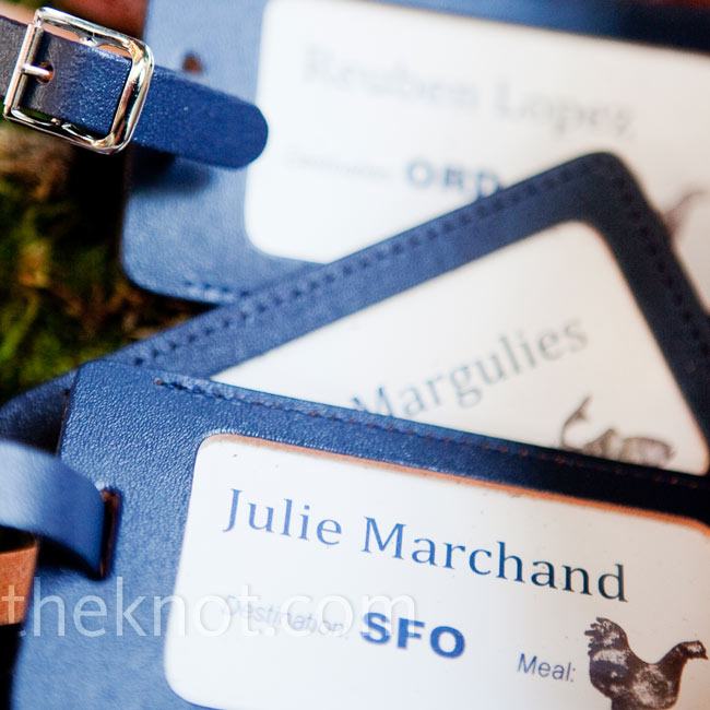 The luggage tag escort cards, displayed in an old suitcase, directed guests to their tables, named after airports the couple had flown into together.