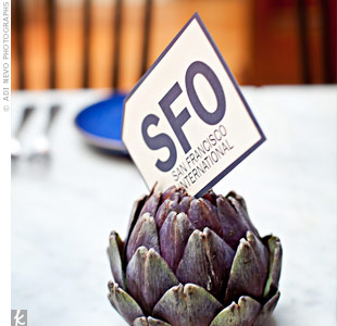 Using artichokes as table card holders was a subtle organic touch.