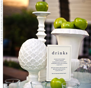 The bar setup included drink menus and apple-filled milk-glass vases.