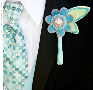 A single felt boutonniere matched James's dotted tie.