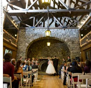 The couple exchanged vows in front of a stone fireplace, which they decorated with white lights and pinwheels.